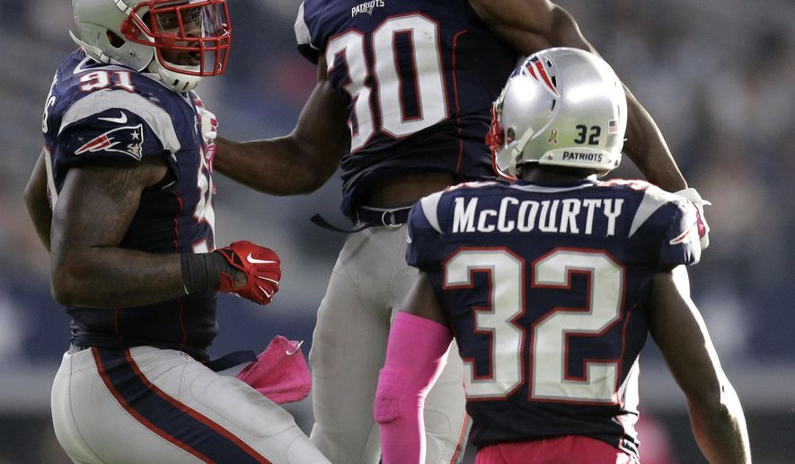 New England Patriots' Jamie Collins (91), Duron Harmon (30) and Devin McCourty (32) celebrates after they recovered fumble by Dallas Cowboys' Jason Witten during the second half of an NFL football game, Sunday, Oct. 11, 2015, in Arlington, Texas. (AP Photo/Tim Sharp)