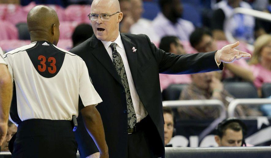Orlando Magic head coach Scott Skiles, right, has words with referee Sean Corbin (33) during the first half of an NBA preseason basketball game against the Miami Heat, Tuesday, Oct. 13, 2015, in Orlando, Fla. (AP Photo/John Raoux)