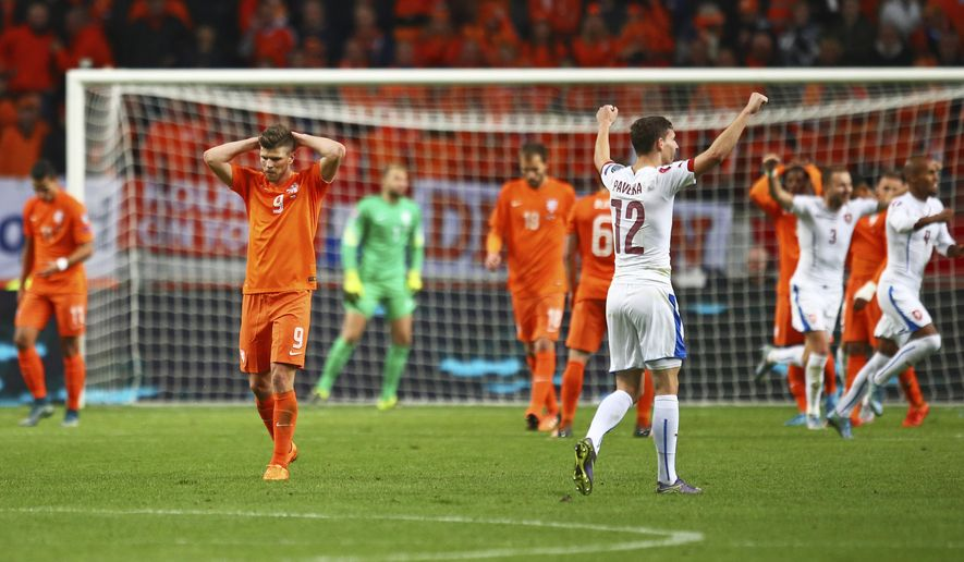 Dutch players with Netherlands' Klaas-Jan Huntelaar, second left, hold their head in despair, after the Czech Republic scored it's third goal during the Euro 2016 qualifying match between the Netherlands and the Czech Republic, at the ArenA stadium, in Amsterdam, Netherlands, Tuesday, Oct. 13, 2015. (AP Photo/Peter Dejong)