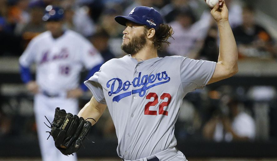 Los Angeles Dodgers pitcher Clayton Kershaw (22) delivers against the New York Mets during the first inning of baseball's Game 4 of the National League Division Series, Tuesday, Oct. 13, 2015, in New York. (AP Photo/Kathy Willens)