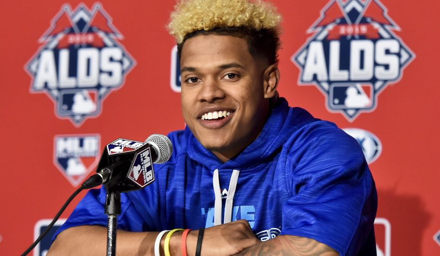 Toronto Blue Jays starting pitcher Marcus Stroman smiles during a baseball press conference, Tuesday, Oct. 13, 2015, in Toronto. The Blue Jays host the Texas Rangers in Game 5 of the American League Division Series on Wednesday. The best-of-five games series is tied 2-2. (Nathan Denette/The Canadian Press via AP) MANDATORY CREDIT