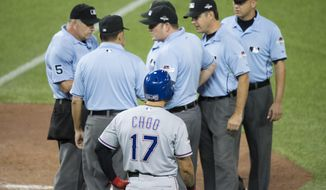 Texas Rangers' Shin-Soo Choo, of South Korea, waits as the umpire crew discusses a play during the seventh inning in Game 5 of baseball's American League Division Series against the Toronto Blue Jays, Wednesday, Oct. 14, 2015, in Toronto. The Blue Jays clinched their first trip to the American League Championship Series since 1993, overcoming one of the most bizarre plays in playoff history by taking advantage of three Rangers errors for a 6-3 victory.  (Darren Calabrese/The Canadian Press via AP) MANDATORY CREDIT