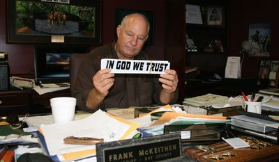"""Sheriff Frank McKeithen of Bay County, Florida, has no plans to remove """"In God We Trust"""" bumper stickers from his patrol cars or to pull videos with religious content from his office's website despite a lawsuit threat. (Tom Quimby/Special to The Washington Times)"""