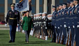 South Korean President Park Geun-hye reviews the troops during a full military honors parade to welcome her, Thursday at the Pentagon. (Associated Press)