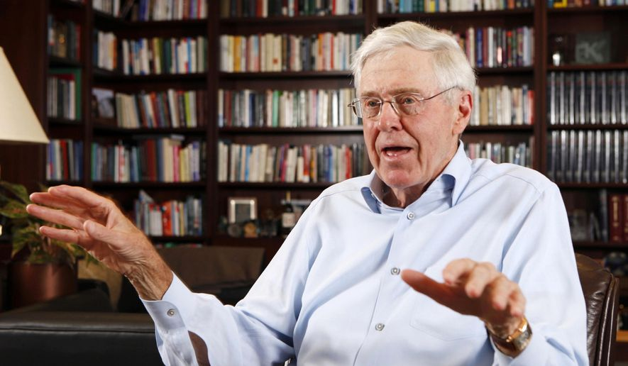 In this May 22, 2012, file photo, Charles Koch speaks in his office at Koch Industries in Wichita, Kan. (Bo Rader/The Wichita Eagle via AP, File)