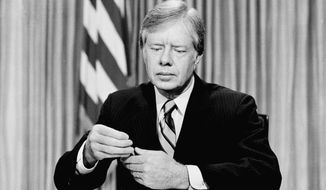 President Jimmy Carter prepares to address the American people on nationwide television from the Oval Office at the White House, April 25 ,1980 in Washington, on the failed mission to rescue the American hostages from Iran. (AP Photo)  ** FILE **