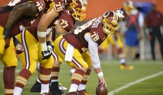 Washington Redskins center Kory Lichtensteiger calls a play during an NFL preseason football against the Cleveland Browns Thursday, Aug. 13, 2015, in Cleveland. Washington won 20-17. (AP Photo/David Richard)