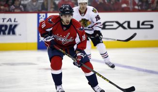 Washington Capitals center Chandler Stephenson skates with the puck in the third period of an NHL hockey game against the Chicago Blackhawks, Thursday, Oct. 15, 2015, in Washington. The Capitals won 4-1. (AP Photo/Alex Brandon) **FILE**