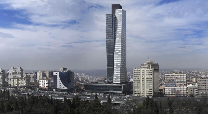 Trump Towers Istanbul -  Donald Trump licenses his name, but is not an owner, of these two conjoined towers in Istanbul, Turkey.  One is an office tower, and the other has 200 luxury apartments, with floor to ceiling windows, spa and fitness center, an indoor pool, business center and a 24-hour doorman.  Photo: www.archello.com