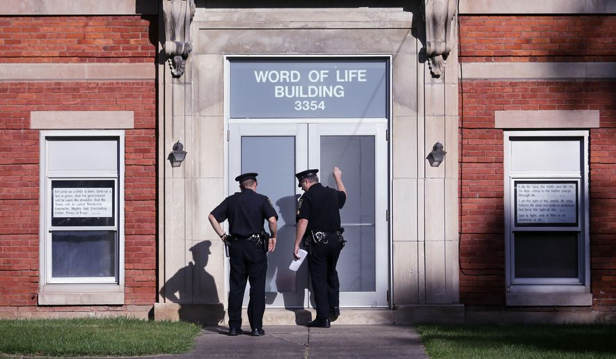 Police knock on the door of the Word of Life church while serving paperwork on a church member, Thursday, Oct. 15, 2015, in New Hartford, N.Y. Bruce and Deborah Leonard have been charged in the beating death of their son, Lucas, and the severe beating of his 17-year-old brother, Christopher, inside the church on Sunday. Four other adults were charged with assault in the younger brother's beating, including Sarah Ferguson, 33, the victims' sister. (AP Photo/Mike Groll)