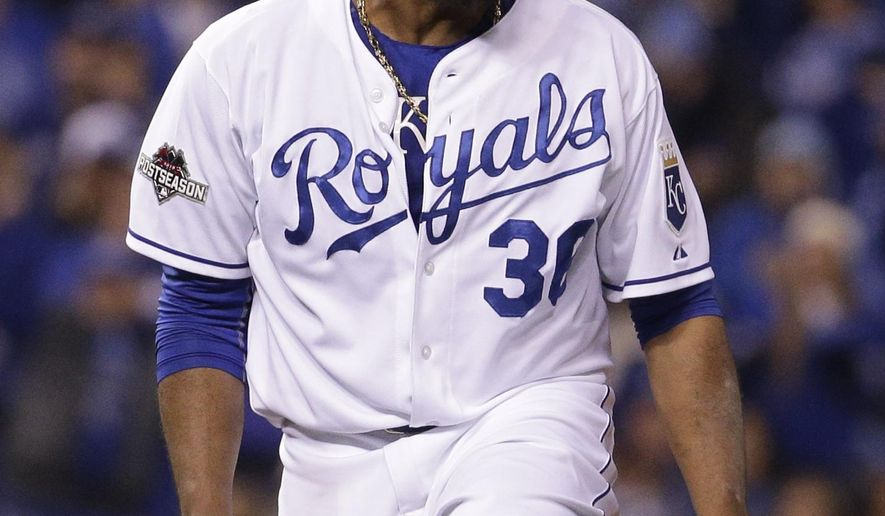 Kansas City Royals starting pitcher Edinson Volquez celebrates after the last out in the top of the sixth inning against the Toronto Blue Jays in Game 1 of baseball's American League Championship Series on Friday, Oct. 16, 2015, in Kansas City, Mo. (AP Photo/Charlie Riedel)