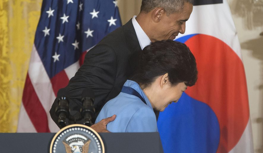 President Barack Obama and South Korean President Park Geun-hye walk off stage at the conclusion of their joint news conference in the East Room of the White House in Washington, Friday, Oct. 16, 2015. (AP Photo/Pablo Martinez Monsivais)