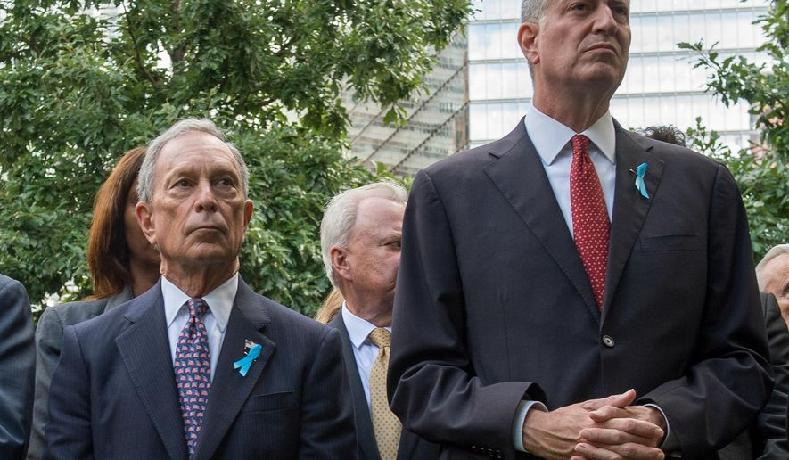 FILE - In this Sept. 11, 2015 file photo, former mayor of New York Michael Bloomberg stands beside current Mayor Bill de Blasio while attending a ceremony at the World Trade Center site in New York. De Blasio and his predecessor Bloomberg are planning to make peace. De Blasio, a Democrat, and Bloomberg, a Republican-turned-independent, will hold a joint news conference Oct. 21 in the Bronx to plant the millionth tree of the Million Trees NYC program that Bloomberg launched in 2007 to improve the quality of life on the city's streets.  (AP Photo/Bryan R. Smith, File)