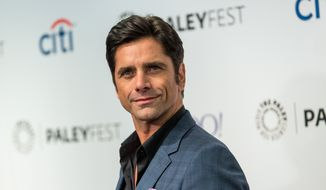 John Stamos attends the at 2015 PaleyFest Fall TV Previews at The Paley Center for Media in Beverly Hills, Calif., in this Sept. 15, 2015, file photo. Los Angeles prosecutors charged Stamos on Wednesday, Oct. 14, 2015, with one count of driving under the influence of a drug stemming from his arrest in June in Beverly Hills. (Photo by Paul A. Hebert/Invision/AP, File)