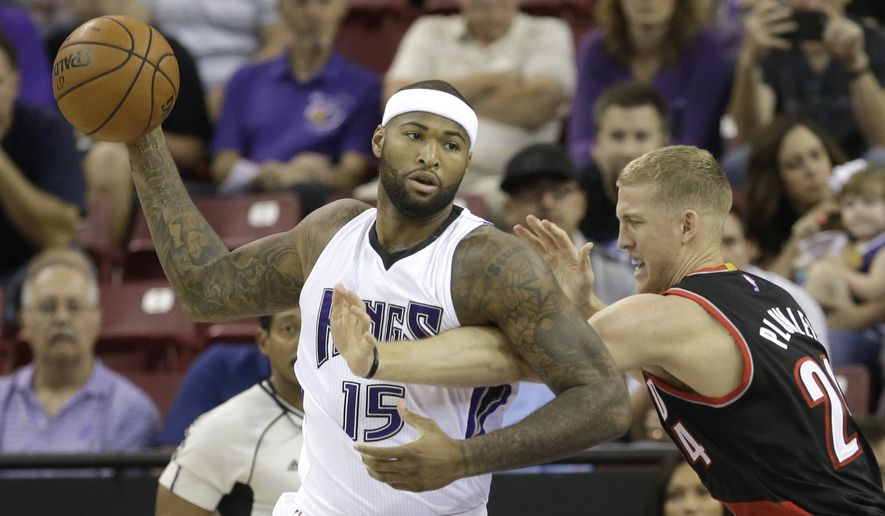 FILE - In this Oct. 10, 2015, file photo, Sacramento Kings center DeMarcus Cousins, left, keeps the ball out of the reach of Portland Trail Blazers center Mason Plumlee during the first quarter of an NBA preseason basketball game in Sacramento, Calif. The Kings signed several free agents over the summer  with the hope that those additions, around All-Star center Cousins, will help end the second longest playoff drought in the NBA.(AP Photo/Rich Pedroncelli, File)