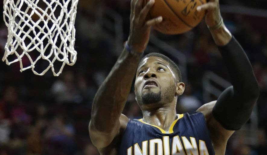 Indiana Pacers' Paul George jumps to the basket in the first half of an NBA preseason basketball game against the Cleveland Cavaliers, Thursday, Oct. 15, 2015, in Cleveland. (AP Photo/Tony Dejak)