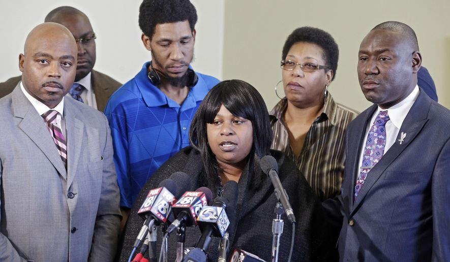 Samaria Rice, center, speaks about the investigation into the death of her son Tamir Rice, at a news conference with attorneys Walter Madison, left, and Benjamin Crump in Cleveland in this Jan. 6, 2015, file photo. (AP Photo/Mark Duncan, File)