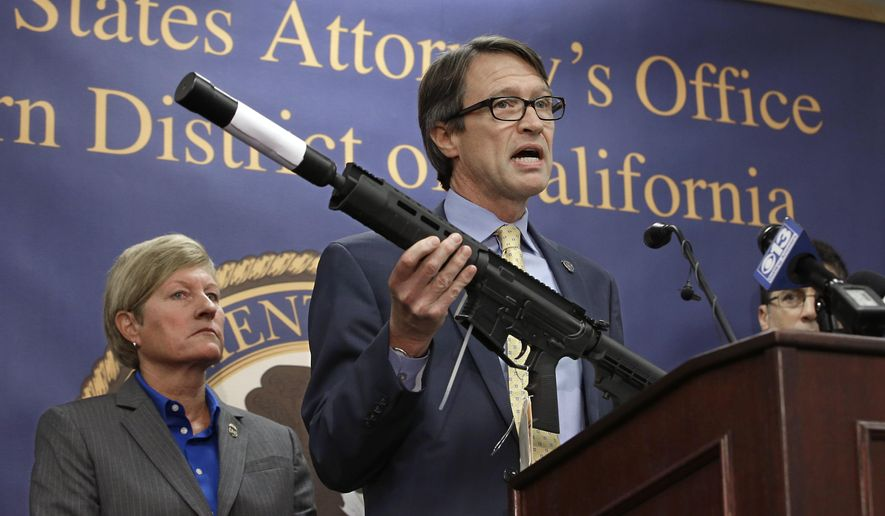 Benjamin Wagner, the United States Attorney for the Eastern District of California, displays one of the guns seized in an undercover operation, during a news conference in Sacramento, Calif., on Oct. 15, 2015. Wagner announced a federal grand jury indicted 8 men on a variety of firearm charges including the manufacturing and dealing in firearms without a license.  At left is Jill A. Snyder, Special Agent in Charge for the Bureau of Alcohol, Tobacco, Firearms and Explosives. (Associated Press) **FILE**
