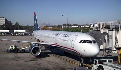 In this image taken from video, US Airways flight 1939, the final US Airways flight, prepares to depart Philadelphia International Airport for Charlotte, N.C. on Friday, Oct. 16, 2015. All future flights will fly under the American Airlines banner, following the completion of a merger announced in 2013. (AP Photo)
