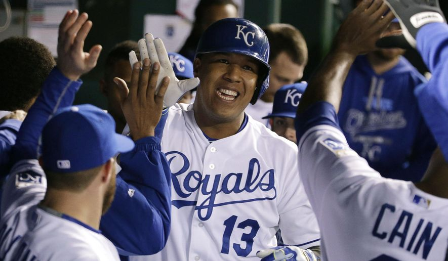 Kansas City Royals' Salvador Perez celebrates his home run during the fourth inning in Game 1 of baseball's American League Championship Series against the Toronto Blue Jays on Friday, Oct. 16, 2015, in Kansas City, Mo.  (AP Photo/Charlie Riedel)