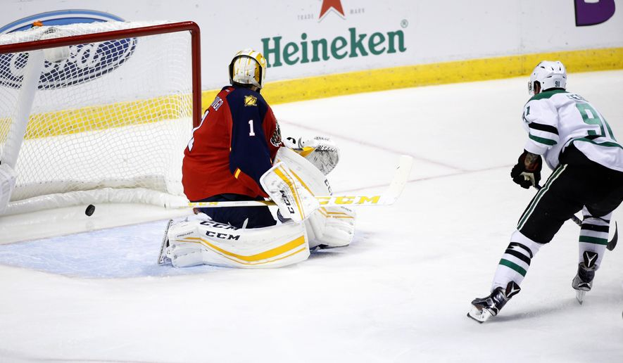 Florida Panthers goalie Roberto Luongo (1) looks back as Dallas Stars center Tyler Seguin (91) scores a goal during the second period of an NHL hockey game, Saturday, Oct. 17, 2015 in Sunrise, Fla. (AP Photo/Wilfredo Lee)
