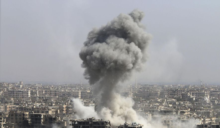 In this photo taken on Wednesday, Oct. 14, 2015, smoke rises after shelling by the Syrian army in Jobar, Damascus, Syria. Backed by Russian airstrikes, the Syrian army has launched an offensive in central and northwestern regions. (Alexander Kots/Komsomolskaya Pravda via AP)