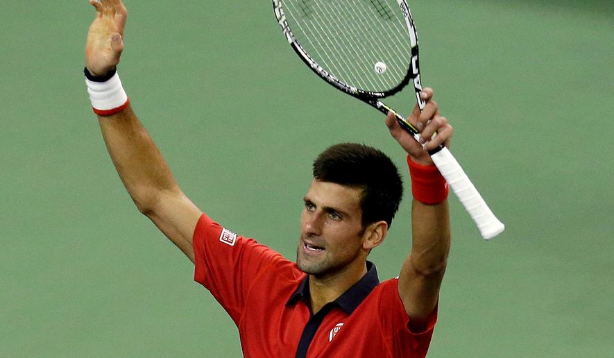 Novak Djokovic of Serbia celebrates after winning his semifinal match against Andy Murray of Britain in the Shanghai Masters tennis tournament in Shanghai, China, Saturday, Oct. 17, 2015. (AP Photo/Andy Wong)