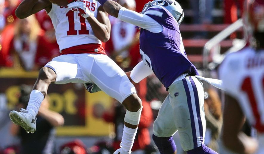 Oklahoma wide receiver Dede Westbrook (11) makes a catch over Kansas State defensive back Duke Shelley (8) during the first half of an NCAA college football game in Manhattan, Kan., Saturday, Oct. 17, 2015. (AP Photo/Nati Harnik)