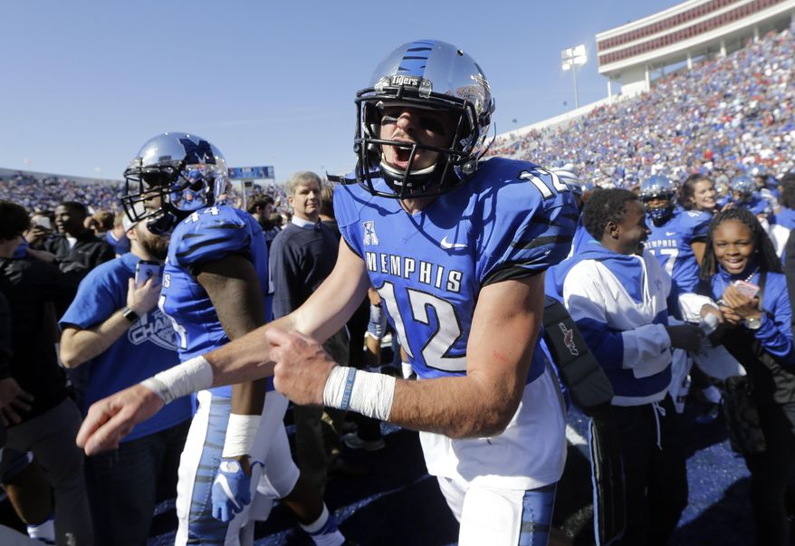 Memphis quarterback Paxton Lynch (12) yells as he celebrates after Memphis upset No. 13 Mississippi 37-24 in an NCAA college football game Saturday, Oct. 17, 2015, in Memphis, Tenn. (AP Photo/Mark Humphrey)