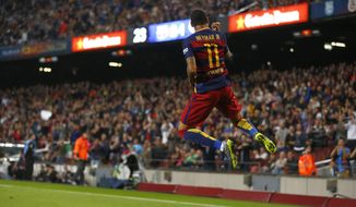 FC Barcelona's Neymar, from Brazil, reacts after scoring against Rayo Vallecano during a Spanish La Liga soccer match at the Camp Nou stadium in Barcelona, Spain, Saturday, Oct. 17, 2015. (AP Photo/Manu Fernandez)