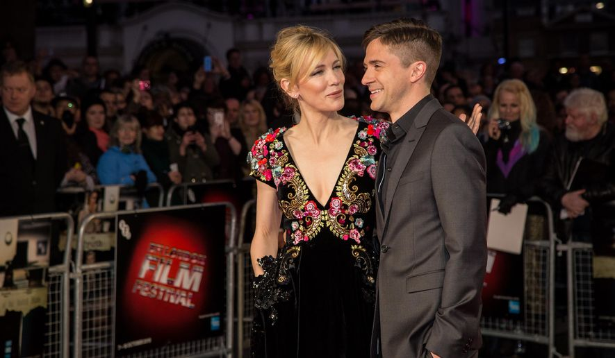 "Actors Cate Blanchett, left, and Topher Grace pose for photographers upon arrival at the premiere of the film ""Truth"", as part of the London film festival in London, Saturday, Oct. 17, 2015. (Photo by Vianney Le Caer/Invision/AP)"
