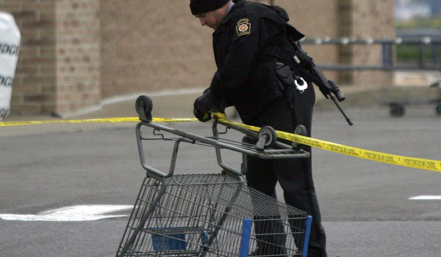 CORRECTS PHOTOGRAPHER- State Trooper sets up a police line using a shopping cart following reports of shots fired near a Wal-Mart store in Wilkes-Barre, Pa., Saturday, Oct. 17, 2015. Police in northeastern Pennsylvania have a suspect in custody. (Dave Scherbenco/The Citizens' Voice via AP) MANDATORY CREDIT