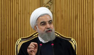 President Obama and other Western leaders have been duped into believing President Hassan Rouhani is moderate, MEK member Farzad Madadzadeh said. (Associated Press)