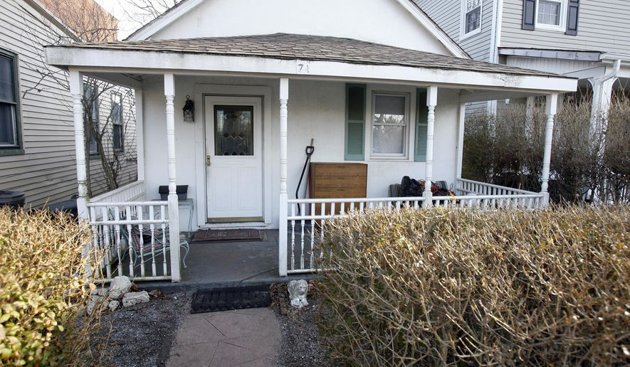 """A March 2009 photos shows a house at 7 1/2 West End Court, in Long Branch, N.J., where Springsteen has said that he wrote every song on the """"Born to Run"""" album. The Jersey shore home is back on the market. The two-bedroom cottage is owned by three fans of the singer. They bought it in 2009 with the idea of turning the home into a tribute to the New Jersey rock legend, but those plans were derailed.  (Andy Mills/The Star-Ledger via AP)  TV OUT; MAGS OUT; INTERNET OUT; NO SALES; NO ARCHIVING; MANDATORY CREDIT  ANDREW MILLS/THE STAR-LEDGER"""