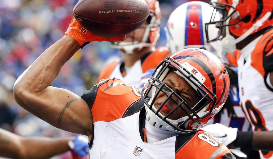 Cincinnati Bengals wide receiver Marvin Jones (82) celebrates his touchdown against the Buffalo Bills during the second half of an NFL football game on Sunday, Oct. 18, 2015, in Orchard Park, N.Y. (AP Photo/Bill Wippert)