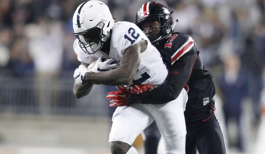 Penn State wide receiver Chris Godwin, left, is tackled by Ohio State cornerback Eli Apple during the second half of an NCAA college football game Saturday, Oct. 17, 2015, in Columbus, Ohio. Ohio State beat Penn State 38-10. (AP Photo/Paul Vernon)