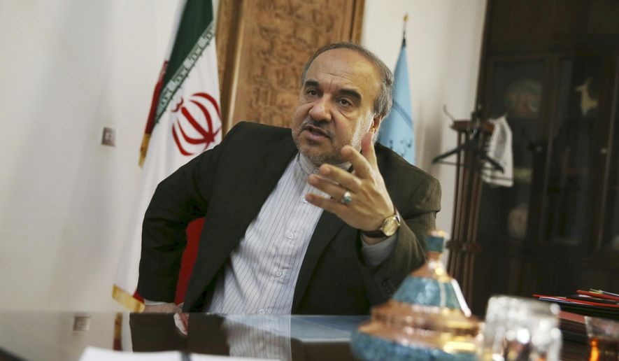 Iran's Vice President Masoud Soltanifar who is also chief of Cultural Heritage, Handicrafts and Tourism Organization gestures as he speaks in an interview with The Associated Press at his office in Tehran, Iran, Sunday, Oct. 18, 2015. Iran's vice president has told The Associated Press his country is preparing for a 'tsunami of tourists' as Iran and world powers are set to begin implementing a landmark nuclear deal that will lift biting sanctions in return for curbs on Iran's nuclear program. (AP Photo/Vahid Salemi)