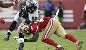 Baltimore Ravens wide receiver Steve Smith (89) is tackled by San Francisco 49ers strong safety Jaquiski Tartt (29) during the second half of an NFL football game in Santa Clara, Calif., Sunday, Oct. 18, 2015. (AP Photo/Marcio Jose Sanchez)