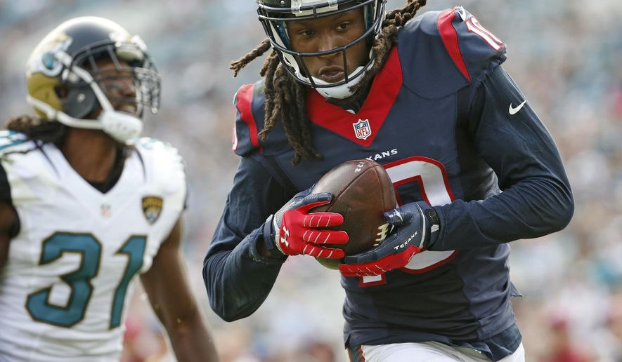 Houston Texans wide receiver DeAndre Hopkins (10) makes a catch for a 26-yard touchdown in front of Jacksonville Jaguars cornerback Davon House (31) during the second half of an NFL football game in Jacksonville, Fla., Sunday, Oct. 18, 2015.(AP Photo/Stephen B. Morton)