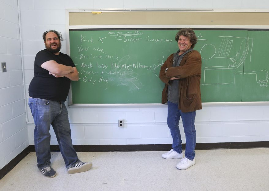 In this Wednesday, Oct. 14, 2015 photo, Paul Green, left, and Michael Lang pose at the former Zena Elementary School in Woodstock, N.Y. Lang and Green have co-founded the Woodstock Music Lab, a rock school for college-age students, with hopes of opening the school sometime in 2016. (AP Photo/Mike Groll)