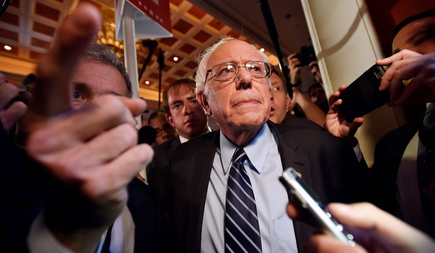 An analysis by The Wall Street Journal found that if Vermont Sen. Bernard Sanders is elected president in 2016 and gets all of his wishes for free college and health care and more social programs, the costs would be in the trillions. (Associated Press)