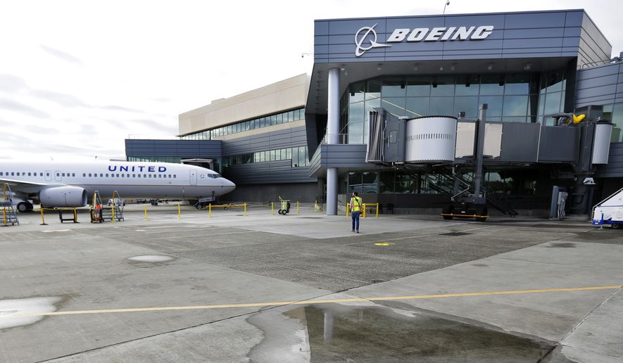 A new Boeing 737-900ER airplane being delivered to United Airlines is parked in front of Boeing's newly expanded 737 delivery center at Boeing Field in Seattle on Oct. 19, 2015. (Associated Press)