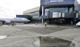 A new Boeing 737-900ER airplane being delivered to United Airlines is parked in front of Boeing's newly expanded 737 delivery center at Boeing Field in Seattle on Oct. 19, 2015. (Associated Press) **FILE**