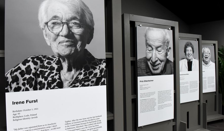 Portraits of Pittsburgh area holocaust survivors and their biographies are on display at the Holocaust Center of Pittsburgh, Sunday, Oct. 18, 2015. They are part of the Center's In Celebration of Life: Living Legacy Project exhibit. The Center held a grand opening Sunday. (Bob Donaldson/Pittsburgh Post-Gazette via AP) MAGS OUT; NO SALES; MONESSEN OUT; KITTANNING OUT; CONNELLSVILLE OUT; GREENSBURG OUT; TARENTUM OUT; NORTH HILLS NEWS RECORD OUT; BUTLER OUT; MANDATORY CREDIT