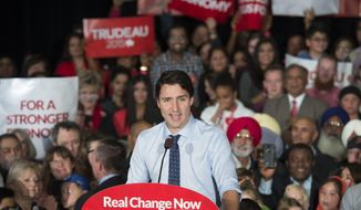 Liberal leader Justin Trudeau addresses supporters during a rally, Sunday, Oct. 18, 2015 in Edmonton. Polls show Conservative Prime Minister Stephen Harper narrowly trailing Trudeau, the son of late Prime Minister Pierre Trudeau. Canadians go to the polls on Monday. (Paul Chiasson/The Canadian Press via AP)