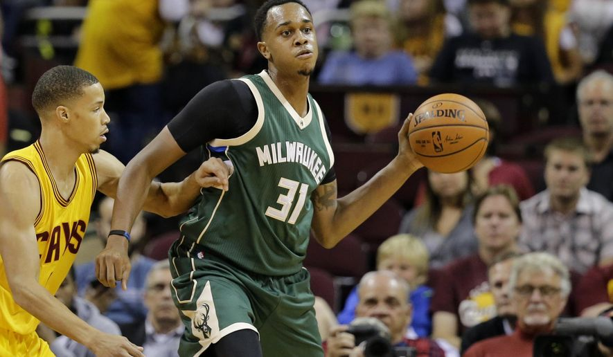 FILE- In this Oct. 13, 2015, file photo, Milwaukee Bucks' John Henson (31) passes against the Cleveland Cavaliers in the first half of an NBA basketball game in Cleveland. Henson says he was racially profiled at a Wisconsin jewelry store in an incident the shop owner says was a misunderstanding. Henson posted an account of the incident Monday, Oct. 19, on Instagram. (AP Photo/Tony Dejak, File)