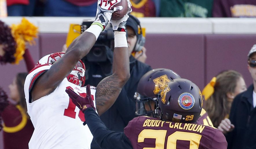 Nebraska wide receiver De'Mornay Pierson-El (15) catches a touchdown pass in front of Minnesota defensive backs Antonio Johnson (11) and Briean Boddy-Calhoun (29) during the second half an NCAA college football game, Saturday, Oct. 17, 2015, in Minneapolis. (AP Photo/Ann Heisenfelt)