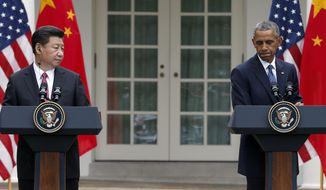 President Obama, right, pauses during a joint news conference with Chinese President Xi Jinping in the Rose Garden of the White House in Washington on Sept. 25, 2015. (Associated Press) **FILE**