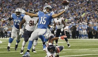 Detroit Lions wide receiver Golden Tate (15) reaches for the ball after Chicago Bears cornerback Kyle Fuller (23) knocked the ball away after Tate crossed the goal line for a touchdown during the first half of an NFL football game, Sunday, Oct. 18, 2015, in Detroit. (AP Photo/Duane Burleson)