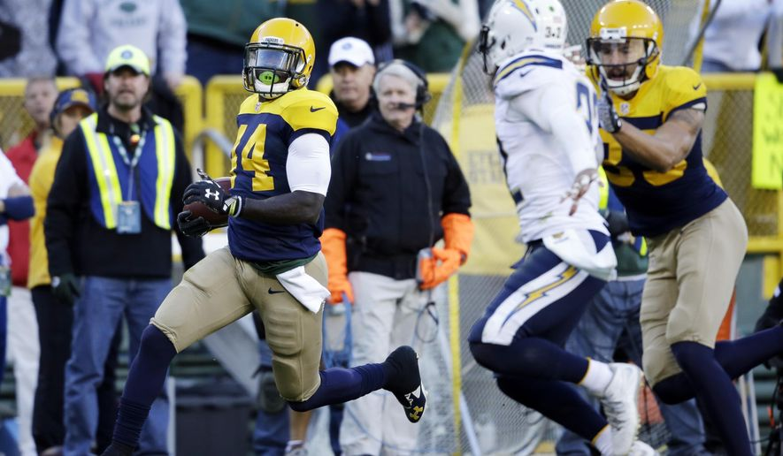 Green Bay Packers' James Starks (44) runs 65-yards for a touchdown during the first half of an NFL football game against the San Diego Chargers, Sunday, Oct. 18, 2015, in Green Bay, Wis. (AP Photo/Jeffrey Phelps)